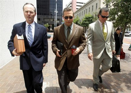 Actor Stephen Baldwin (C), arrives with his attorneys Timothy Madden (L) and Leo Palazzo at the New Orleans Federal Court House in New Orlea