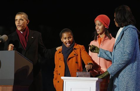U.S. President Barack Obama (L) counts down as daughter Sasha (2nd L), prepares to light the National Christmas Tree next to her sister Mali