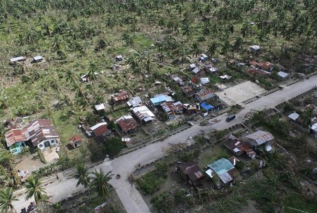 An aerial view of damaged houses caused by flash floods in Compostela Valley province, southern Philippines is seen in this handout photogra