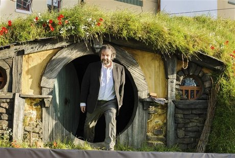 New Zealand director Peter Jackson emerges from a 'Hobbit Hole' to make an address at the world premiere of 'The Hobbit - An Unexpected Jour