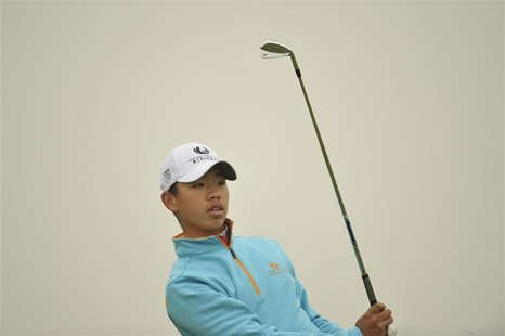Guan Tian-Lang of China watches his shot during the Championship Pro-Am of the Volvo China Open at Binhai Lake Golf Club in Tianjin municipa