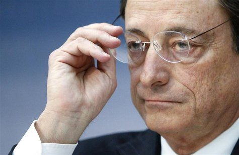 European Central Bank (ECB) President Mario Draghi takes off his glasses during the monthly ECB news conference in Frankfurt December 6, 201