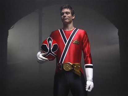 British Tae Kwon Do champion Aaron Cook poses wearing a Power Rangers outfit during a break in filming a promotional film at a location in c
