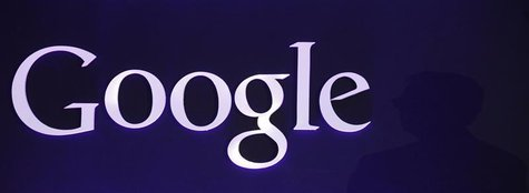 The Google logo is seen as Google Executive Chairman Eric Schmidt speaks at a promotional event for the Nexus 7 tablet in Seoul September 27