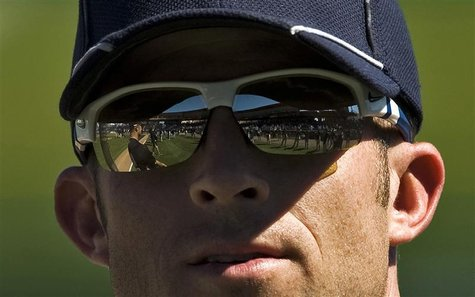 New York Yankees outfielder Brett Gardner stretches with teammates before the start of a spring training baseball game against the Philadelp