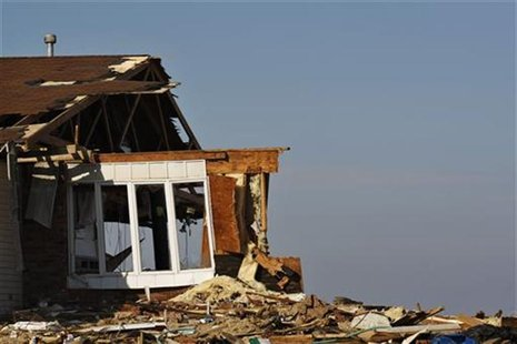 The debris of a home damaged by Superstorm Sandy is seen one month after the disaster at the zone of Union Beach in New Jersey November 29,