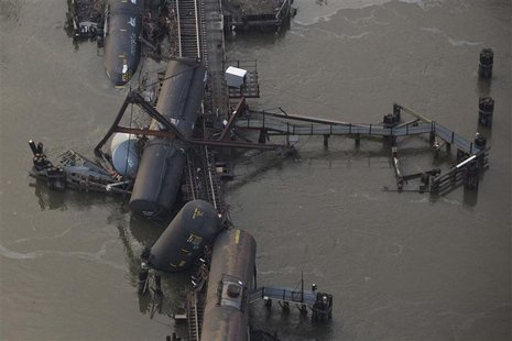 Derailed freight train cars sit semi-submerged in the waters of Mantua Creek after a train crash, in Paulsboro, New Jersey, in this November