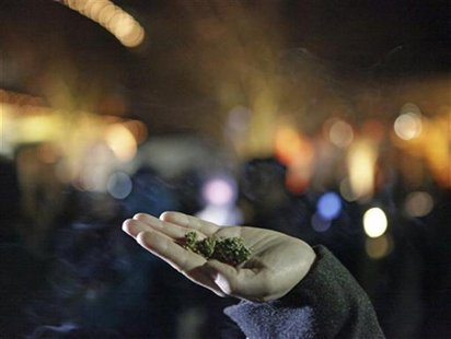 Marijuana is seen in the hand of a person after the law legalizing the recreational use of marijuana went into effect in Seattle, Washington