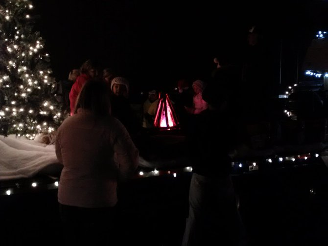 Singing Christmas Carols around the fire and floating through Mosinee during the Holiday Parade, Saturday, December 1, 2012.