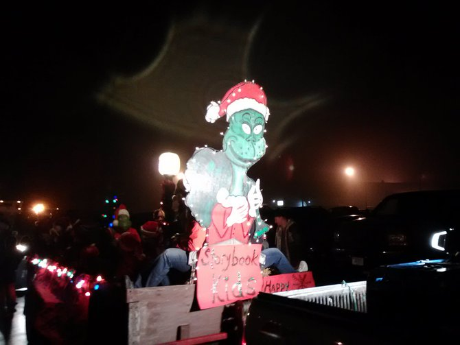 The Grinch tried to steal Christmas at the Mosinee Holiday Parade but he gave back a lot more on Saturday 12/1/2012