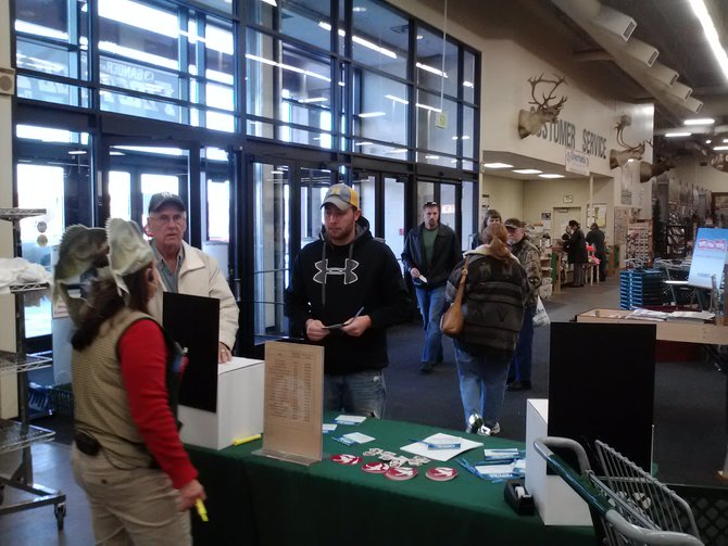 Shoppers registering for over $3,000 in Ice Fishing prizes at the 2012 Wausau First Ice Expo at Gander Mountain in Rothschild, WI