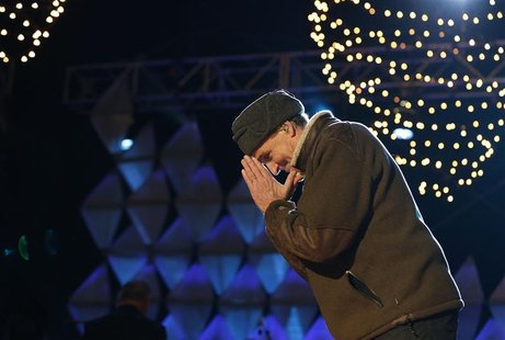 Singer James Taylor thanks the crowd after singing at the end of the show at the official lighting of the National Christmas Tree ceremony o