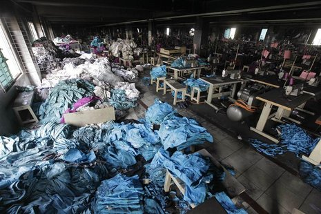 Piles of clothes are seen alongside sewing machines in the Tazreen Fashions garment factory, where 112 workers died in a devastating fire la