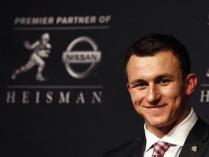 Texas A&M quarterback Johnny Manziel looks on during a news conference after winning the Heisman Trophy award in New York December 8, 2012.