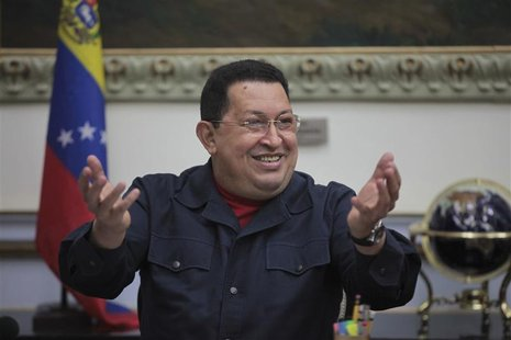 Venezuelan President Hugo Chavez smiles as he speaks during a Council of Ministers at Miraflores Palace in Caracas November 15, 2012. REUTER