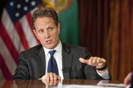 U.S. Treasury Secretary Tim Geithner gestures as he is interviewed by Bob Schieffer (not pictured) in Washington, on November 30, 2012 for t