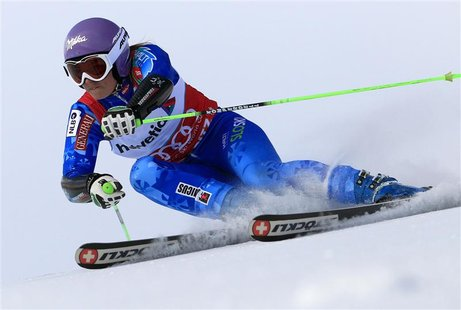 Tina Maze of Slovenia speeds down during the first run of the Giant slalom race at the women's Alpine skiing World Cup at the Corviglia in t