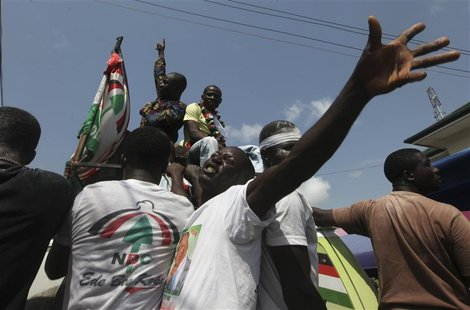 Supporters of National Democratic Congress (NDC) celebrate the victory of their candidate, John Dramani Mahama, on a street in Accra Decembe