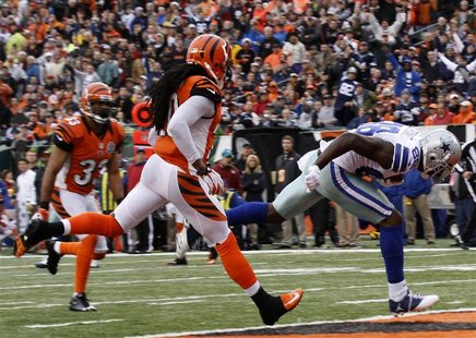 Dallas Cowboys wide receiver Dez Bryant runs in for the touchdown ahead of Cincinnati Bengals' Reggie Nelson (L) during the second half of p