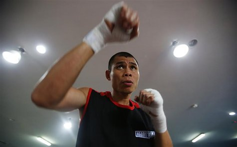 "Chris ""The Dragon"" John of Indonesia shadow boxes during an open training session ahead of his fight at a gym in Singapore November 6, 2012."