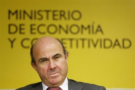 Spanish Economy Minister Luis de Guindos attends a joint news conference with Organisation for Economic Co-operation and Development (OECD)