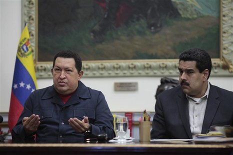 Venezuelan President Hugo Chavez speaks next to Vice President Nicolas Maduro during a national broadcast at Miraflores Palace in Caracas De