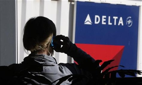 A passenger talks on her phone at a Delta Airlines gate a day before the annual Thanksgiving Day holiday at the Salt Lake City international