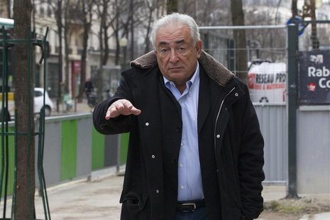 Former IMF head Dominique Strauss-Kahn leaves his apartment in Paris December 10, 2012. REUTERS/Gonzalo Fuentes