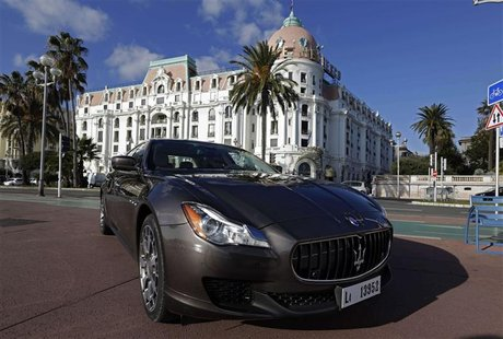 A new Maserati Quattroporte is displayed on the Promenade des Anglais during an international presentation to the media in Nice, December 10