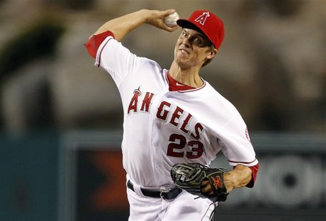 Los Angeles Angels starting pitcher Zack Greinke delivers a pitch against the Texas Rangers during the first inning of their MLB baseball ga