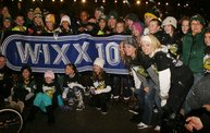 Flash mob dancers with WIXX banner