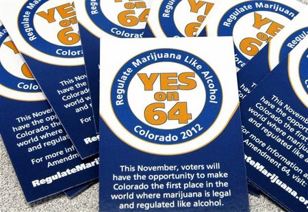 Cards supporting Amendment 64 are seen in campaign offices in Denver, Colorado, May 25, 2012. REUTERS/Rick Wilking