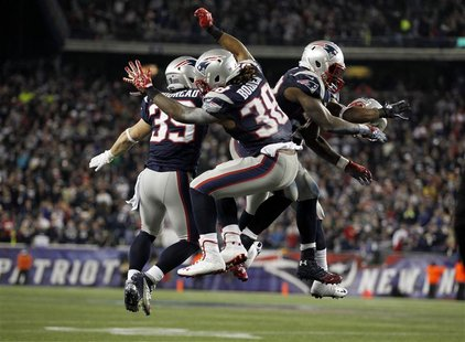 New England Patriots Danny Woodhead (L), Brandon Bolden (C) and Stevan Ridley celebrate after the Patriots scored a touchdown against the Ho