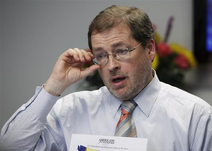Grover Norquist, founder of the taxpayer advocacy group, Americans for Tax Reform (ATR), adjusts his glasses as he speaks during the Reuters