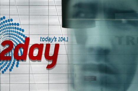 Advertisement is reflected at the entrance of the building that houses the 2Day FM radio station in Sydney December 8, 2012. REUTERS/Daniel