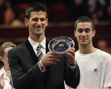 "Serbian tennis player Novak Djokovic with the ""Centrepoint Premier Award for Contribution to the Lives of Youth Across the World"" in recogni"