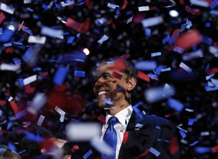 U.S. President Barack Obama celebrates on stage as confetti falls after his victory speech during his election rally in Chicago, November 6,