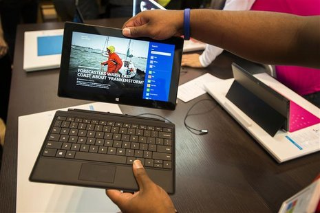 Sales staff demonstrate the Microsoft Surface during the opening of Microsoft's retail store in New York's Times Square October 25, 2012. RE
