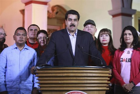 Venezuela's vice President Nicolas Maduro (C) flanked by cabinet members statement about President Hugo Chavez's cancer surgery in Caracas D