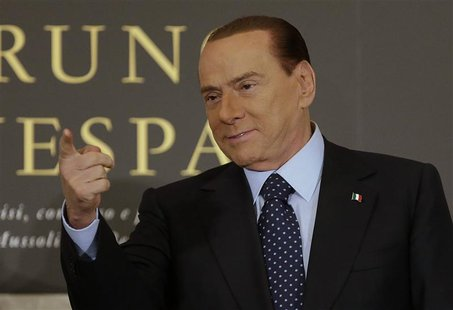 Former Italian Prime Minister Silvio Berlusconi gestures as he arrives to attend the book launch of his friend, TV presenter Bruno Vespa, in