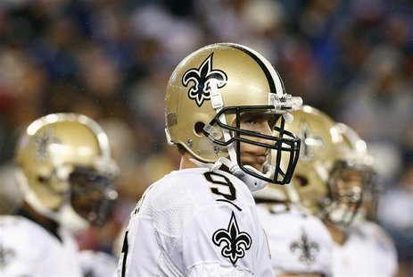 New Orleans Saints' quarterback Drew Brees stands in the rain between plays in the fourth quarter of the Saints' loss to the New York Giants