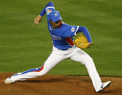 Team Korea's closing pitcher Lim Chang Yong throws against Team Venezuela in the ninth inning during the semifinal game at the World Basebal