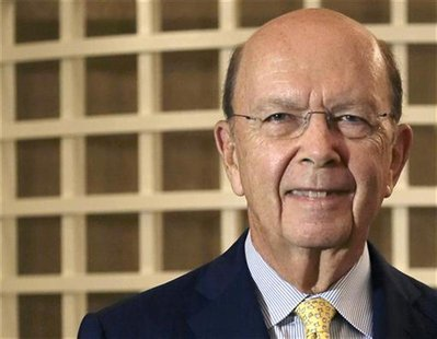 Billionaire U.S. investor Wilbur Ross poses for a photo after an interview with Reuters on the sidelines of a conference at a hotel in Singa