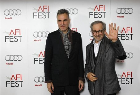 "Director of the movie Steven Spielberg (R) and cast member Daniel Day-Lewis pose at the premiere of ""Lincoln"" during the AFI Fest 2012 at th"