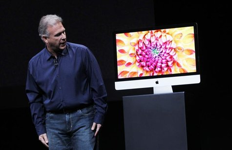 Apple senior vice president of worldwide marketing Philip Schiller displays a new model of the iMac desktop computer during an Apple event i