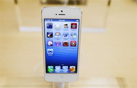 An Apple iPhone 5 phone is displayed in the Apple Store on 5th Avenue in New York in this September 21, 2012 file photo. REUTERS/Lucas Jacks