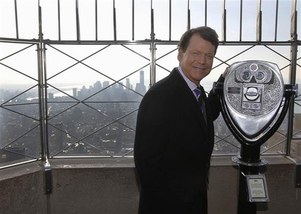 U.S. Ryder Cup captain Tom Watson poses for photographers on the observation deck of the Empire State building in New York, December 13, 201