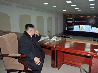 North Korean leader Kim Jong-Un smokes a cigarette at the General Satellite Control and Command Center after the launch of the Unha-3 (Milky