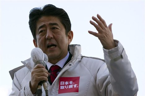 Japan's main opposition Liberal Democratic Party's (LDP) leader and former Prime Minister Shinzo Abe makes a speech during a campaign for th