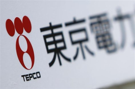 A Tokyo Electric Power Co (TEPCO) logo is pictured on a sign showing the way to the venue of the company's annual shareholders' meeting in T